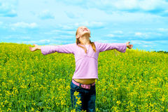 Child on meadow. Happy child on yellow meadow Stock Photos