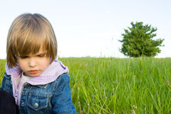 Child in the meadow Stock Image