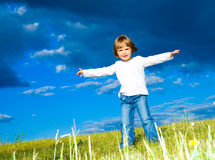 Child in the meadow Stock Photos