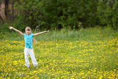 Child on meadow  with hand up. Royalty Free Stock Photography