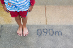 Child and measuring  of swimming pool. Height Stock Photos