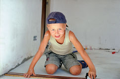 Child measuring wooden plank Stock Images