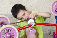 Child mechanic reparing Royalty Free Stock Photo