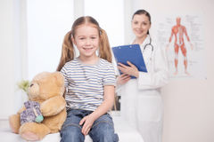 Child on medical exam. Stock Photos