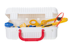 Child Medical Kit. To play doctor, open  full of medical supplies, toys in primary colors red, blue, and yellow.  Isolated Stock Images
