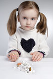 Child and medication. Little girl holding medication in her hand Stock Photo