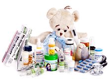 Child medicine and teddy bear. Isolated royalty free stock images