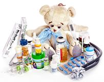Child medicine and teddy bear. Isolated royalty free stock photos