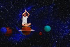 child meditates in space royalty free stock photos