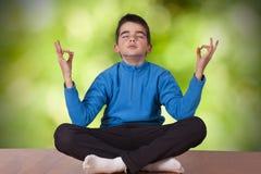 Child meditating yoga Royalty Free Stock Images