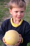 Child and Melon. Child helding a melon stock photography