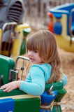Child on merry go round Stock Photo