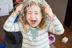 Child with metal party wig shouting Royalty Free Stock Photos
