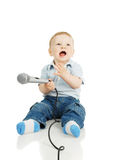 The child and a microphone Royalty Free Stock Images