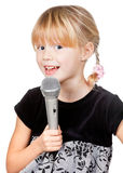 Child with microphone singing Royalty Free Stock Photography