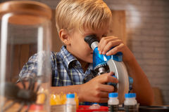 Child with microscope Royalty Free Stock Image