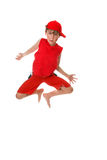 Child mid jump. A barefoot casual boy in mid jump Royalty Free Stock Images