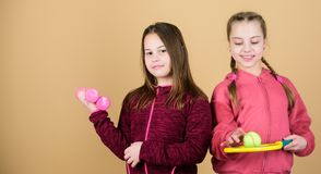 Child might excel in completely different sport. Friends ready for training. Ways to help kids find sport they enjoy. Girls cute kids with sport equipment royalty free stock image