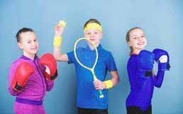 Child might excel completely different sport. Sporty siblings. Girls kids with boxing sport equipment and boy tennis. Player. Ways to help kids find sport they royalty free stock images