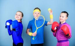 Child might excel completely different sport. Sporty siblings. Girls kids with boxing sport equipment and boy tennis. Player. Ways to help kids find sport they royalty free stock image