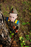 Child in military uniform against nature background Stock Image