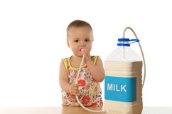 Child & milk. Little cute girl with milk Royalty Free Stock Photography