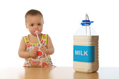 Child & milk. Little cute girl with milk Royalty Free Stock Image