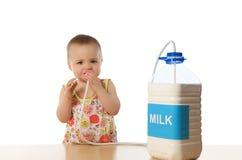 Child & milk. Little cute girl with milk Stock Image