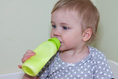 Child with milk bottle Royalty Free Stock Images