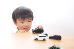 Child and mini car. The child who plays a mini car Stock Image