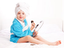 Child with a mirror Stock Image