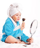 Child with a mirror and a brush Stock Images