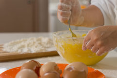 Child mixing ingredients in a mixing bowl Royalty Free Stock Photos