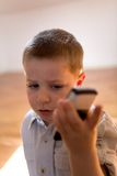 Child with mobile phone Royalty Free Stock Images