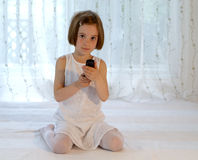 Child with mobile phone - cellphone with SMS Stock Photography