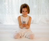 Child with mobile phone - cellphone with SMS Stock Photo