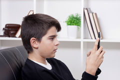 Child with mobile phone Royalty Free Stock Photography