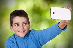 Child with mobile phone, selfie Stock Photos