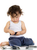 Child with mobile phones. Royalty Free Stock Photos