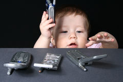 Child with mobile phones Royalty Free Stock Photography