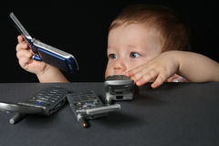 Child with mobile phones Stock Photography