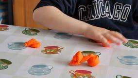 Child modeling orange clay stock footage