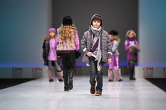 Child models walk the catwalk. MOSCOW - FEBRUARY 22: Unidentified beautiful child models wear fashions from Snowimage and walk the catwalk in the Collection Stock Photos
