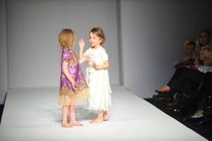 Child models walk the runway at Nancy Vuu show. LOS ANGELES, CA - MARCH 10: Child models walk the  runway at Nancy Vuu Children fashion show during Style Fashion Stock Images