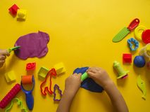 Child mold from colored plasticine.Children`s hand Royalty Free Stock Photos