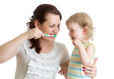 Child with mom brushing teeth isolated Royalty Free Stock Photos