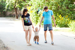 Child with mom and dad walking Stock Photography