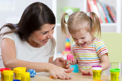 Child with mom make by hands playing with color dough Royalty Free Stock Photography