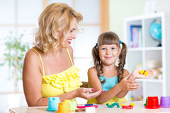 Child with mom making by hands Stock Photography