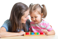 Child and mom playing together with puzzle toy Stock Photo